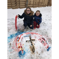 Max and Lucy used paint in the snow