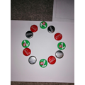 Oscar has made patterns using bottle tops.