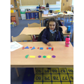 At school the children have made patterns using 2D shapes.