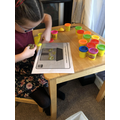 Amelia-Ivy has been making 2D shapes using playdough.