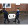 The heavy chest is returned to the school.