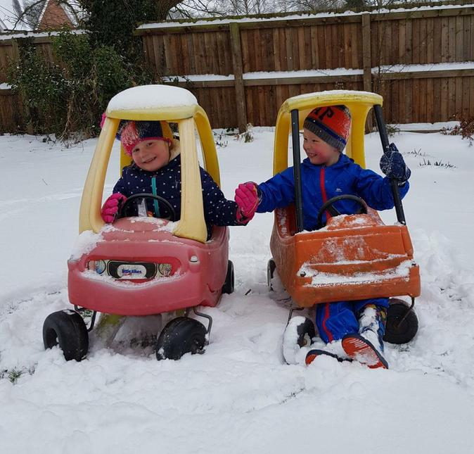 Lily and George driving in the snow