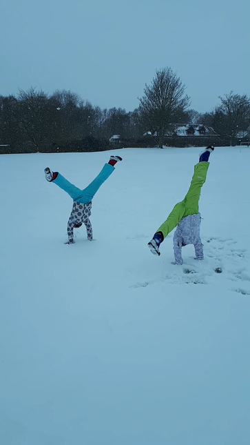 Hannah and Amelia practising gymnastics