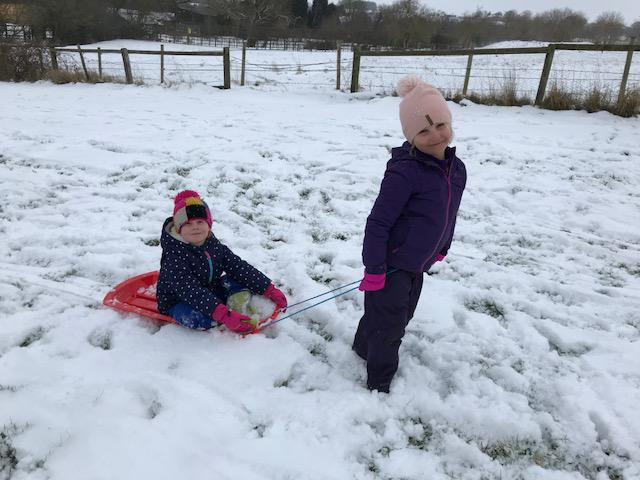 Harriet and Lily sledging