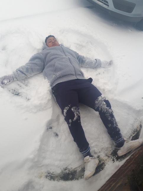 Niyon enjoying the first proper snow