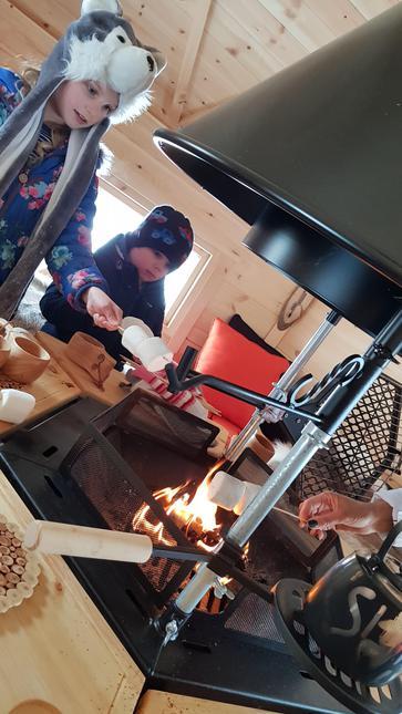 Chloe and Jack toasting marshmallows