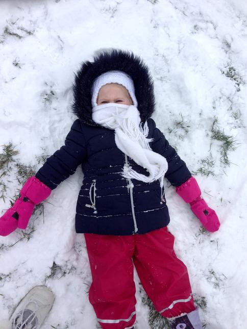 Julia making snow angels