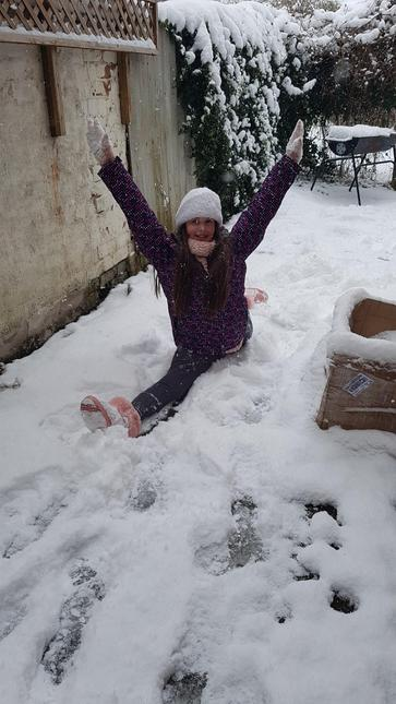 Marilena practising the splits in the garden,