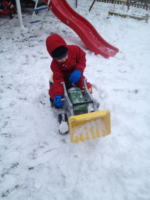Alex clearing snow in the garden