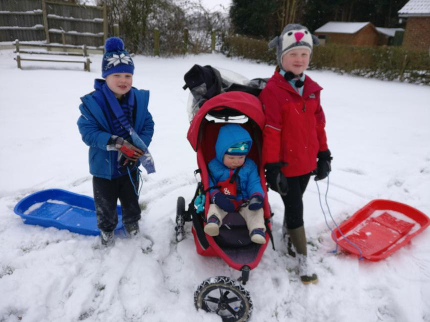Ada, Michael and Rick going sledging