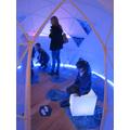 In the igloo.