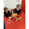 Testing out the marble run, using our pincer fingers.