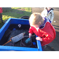 Exploring the ice in the mud kitchen