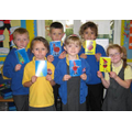 Year 2 pupils proudly showing off their designs