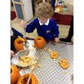 Scooping pumpkins