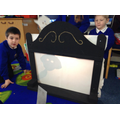 We created our own shadow puppet theatre.
