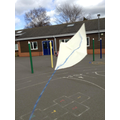 We made our own kites to fly in the wind!