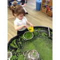 Using fine motor skills to mash peas