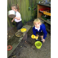 Making mud pies in our mud kitchen
