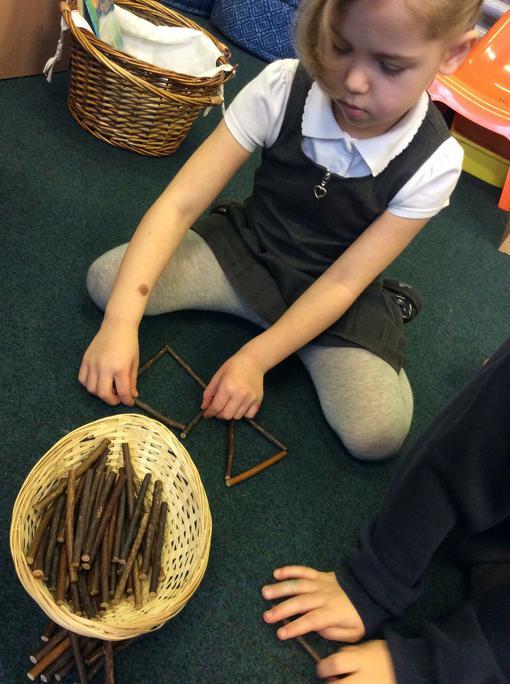 Jessica uses the sticks to make shapes.