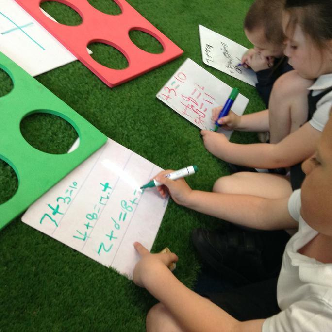 We practise writing number sentences