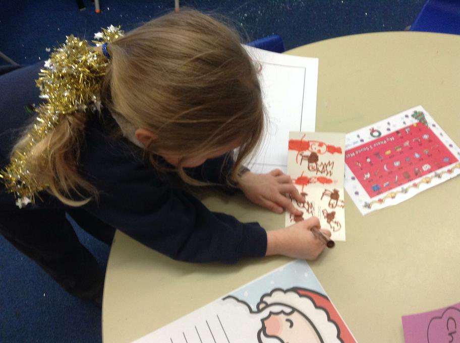 Amber drew pictures of Santa and Rudolph