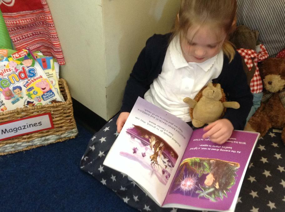 Elizabeth reading a  hedgehog story to Hovis!