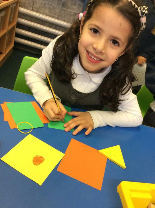 Yasmine is making a shape snap game to play