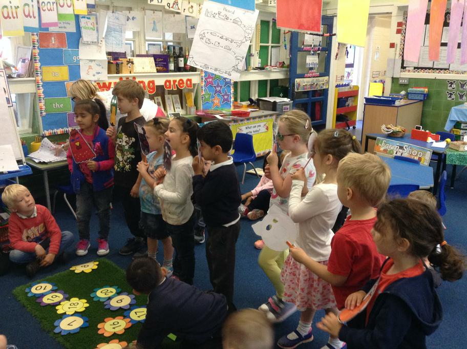 Acting out the story 'What the Ladybird Heard'