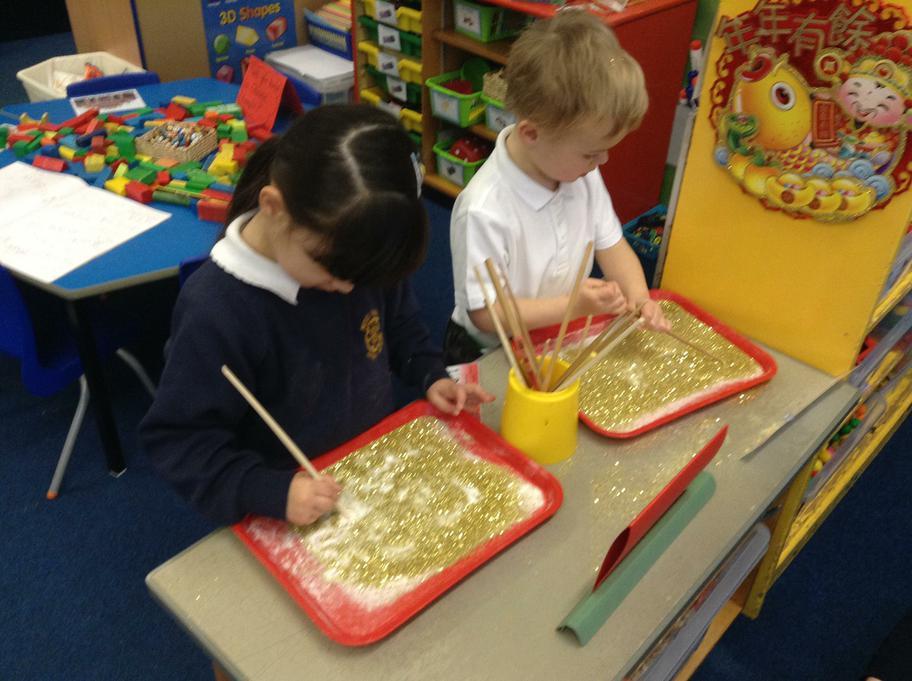 Writing numbers using chopsticks