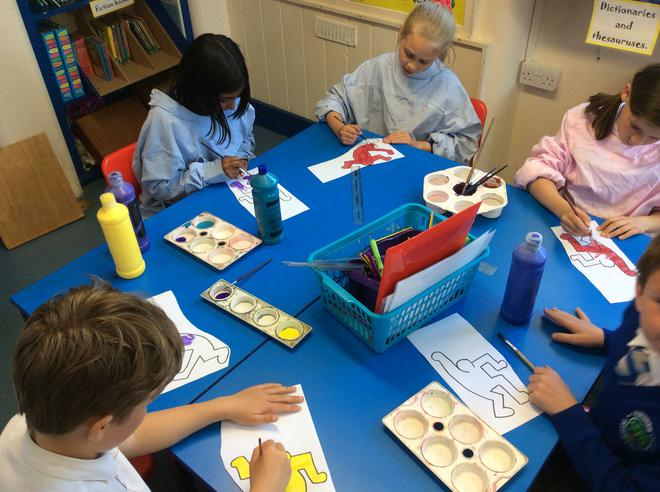 Painting our own Keith Haring figures.