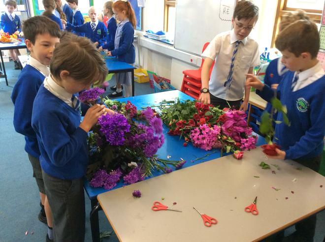 Sorting the flowers into their colours.