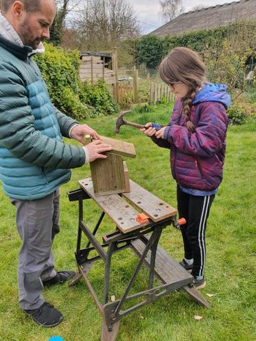 Verity making a bird box