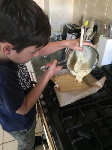 Archie making banana loaf