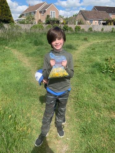 Ethan picking dandelions