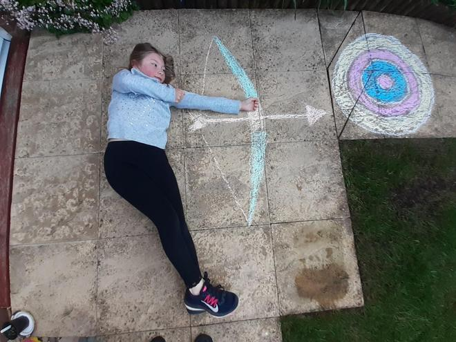 Millie doing some archery