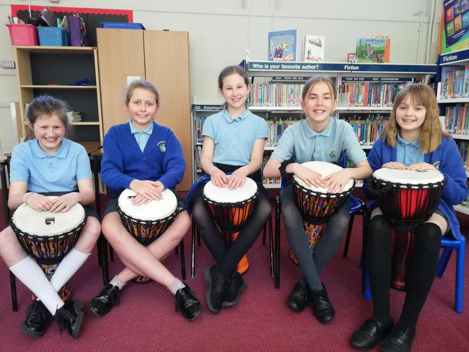 Some members of the Year 6 Drumming Group enjoying the new drums