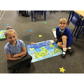 Singing the continents song whilst doing the puzzle of the world