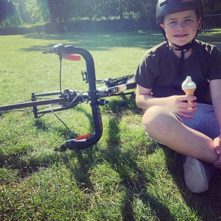 Enjoying his new bike and some sunshine