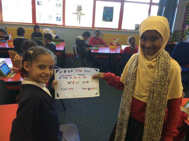 Ilham awarded Tahleelah with a friendship award.