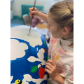 Amelia from Magpie Class, helping to paint Elmer