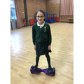 Kate showing of her skills on a hover board