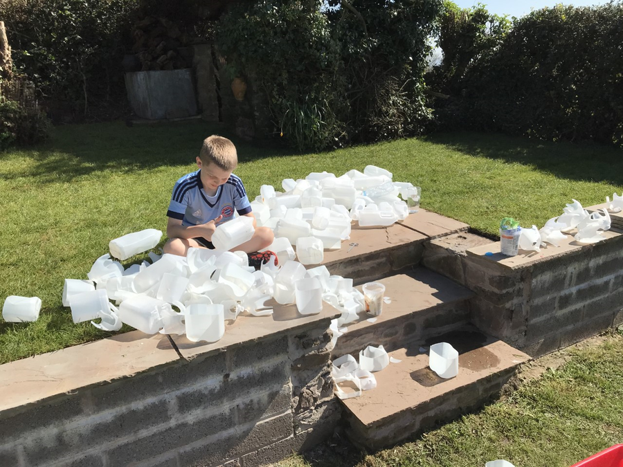 Harry D- making a game from milk bottles.