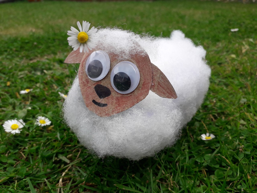 Agatha's sheep joins Alice's in the daisy field.
