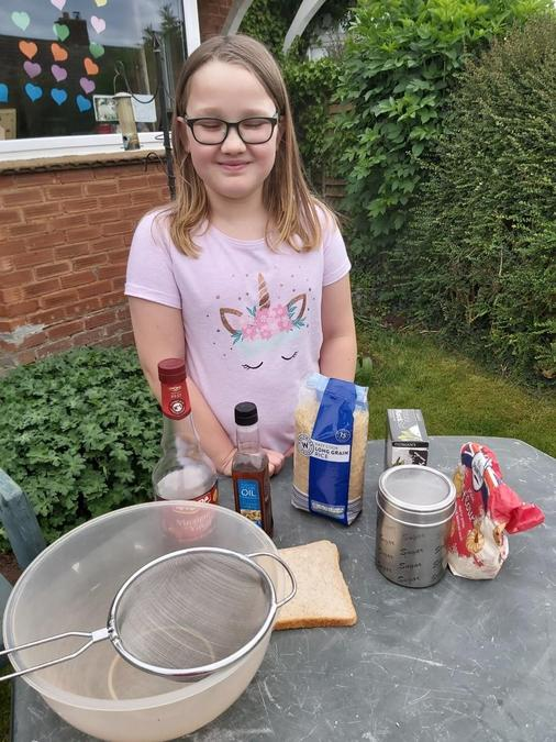Ella's ready for a messy science lesson!