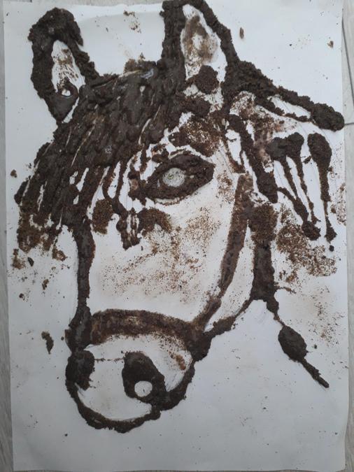 A sand art horse.