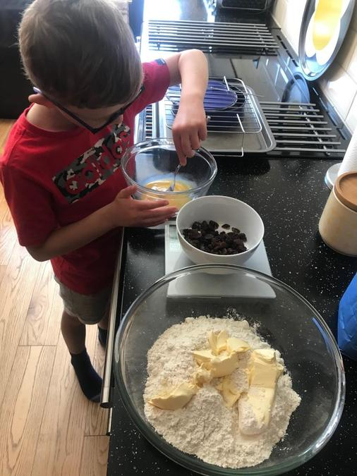 Dylan weighing the ingredients for fruit scones.