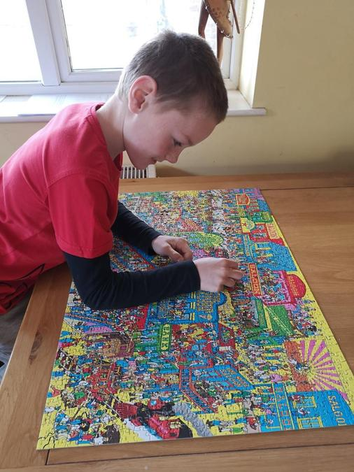 Preston finishing his jigsaw.