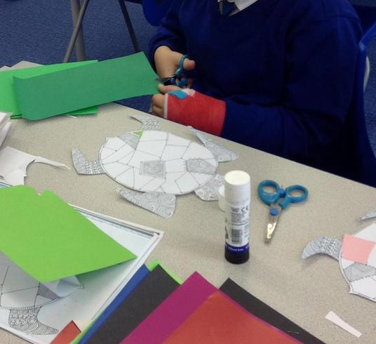 In motor skills we practise cutting, sticking and create imaginative pictures.