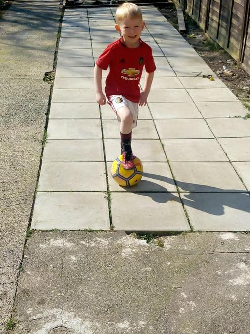 Playing football.